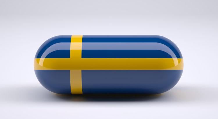 Kapsułka w barwach szwedzkiej flagi